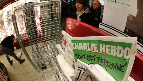 People wait to buy the latest issue of Charlie Hebdo newspaper at a newsstand in Rennes, western France, Wednesday, Jan. 14, 2015 - Sputnik International