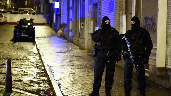 Police stands guard in Verviers, eastern Belgium, on January 15, 2015, after two men were reportedly killed during an anti-terrorist operation - Sputnik International