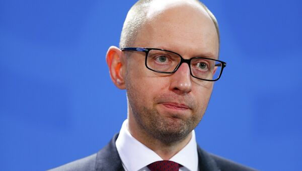 Ukraine's foreign debt should be restructured on reasonable terms for Kiev, otherwise the government will not repay loans, Prime Minister Arseniy Yatsenyuk said. - Sputnik International