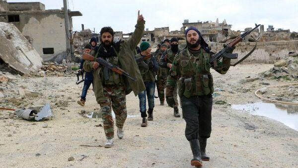 Opposition fighters walk in the al-Breij area northwest on the northern Syrian city of Aleppo - Sputnik International