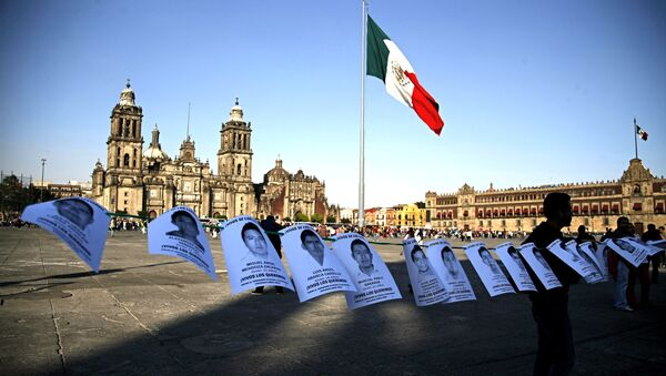 Leaflets with the images of 43 missing students from the state of Guerrero, are shown before a massive protest march, at the Zocalo in Mexico City - Sputnik International
