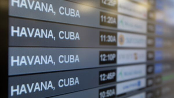 Charter flights from Miami to Havana are shown on a departures monitor at Miami International Airport, Friday, Jan. 16, 2015 in Miami - Sputnik International