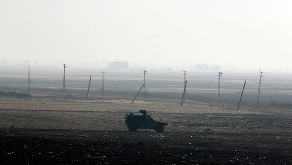 A Turkish forces armoured vehicle is stationed along the border road in Mursitpinar, nn the outskirts of Suruc, on the Turkey-Syria border - Sputnik International