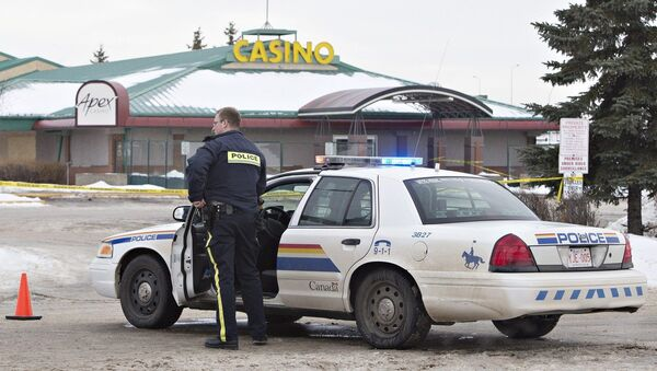 Police contain the scene where two RCMP officers were shot in St. Albert, Alberta, Canada, on Saturday, Jan. 17, 2015 - Sputnik International