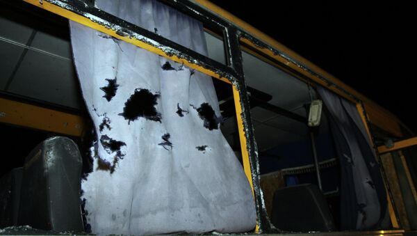 A view of the shattered windows and the torn curtains of a bus hit during shelling apparently aimed at a checkpoint manned by Ukrainian forces in Volnovakha, in the eastern Donetsk region, on January 13, 2015 - Sputnik International