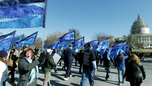 """Law enforcement and family members march during a """"Sea of Blue"""" pro-police rally near the Capitol in Washington on Saturday, Jan. 17, 2015 - Sputnik International"""