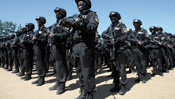 SWAT members of the Beijing Municipal Public Security Bureau stand in formation after conducting a joint anti-terrorism at a training ground on the outskirts of Beijing - Sputnik International