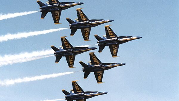 This undated US Navy photo shows Navy F-18's flying in formation piloted by the Blue Angels precision flying team. - Sputnik International