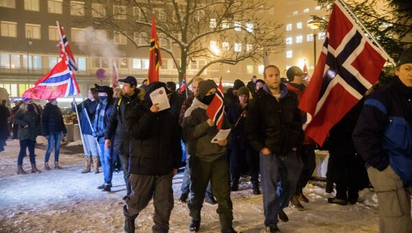 Norwegian sympathizers of the German right-wing populist movement PEGIDA (Patriotic Europeans Against the Islamisation of the Occident) carrying Norwegian flags march in Oslo - Sputnik International