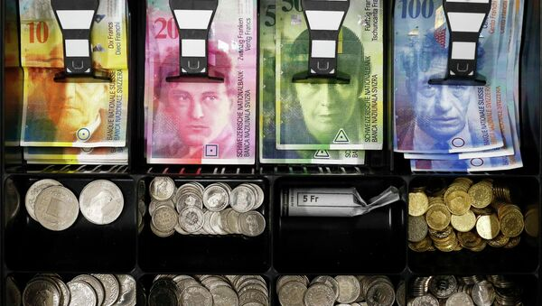 Swiss franc coins are seen in a cash drawer in this picture illustration in Bern - Sputnik International