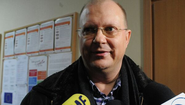 Russian journalist Leonid Sviridov speaks to the press after a three-hour meeting with officials concerning an attempt by Polish authorities to expel him from the country, in Warsaw, Poland, Wednesday, Nov. 26, 2014 - Sputnik International