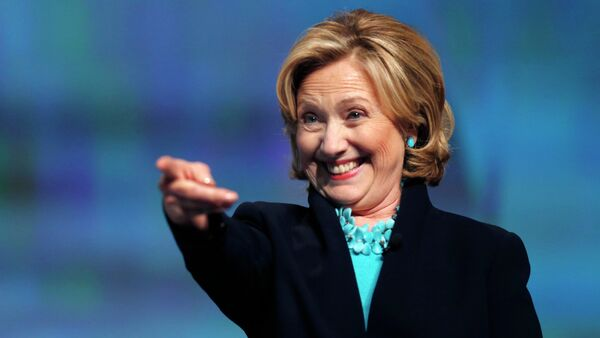 Former Secretary of State Hillary Rodham Clinton reacts as she is introduced to speak at the Massachusetts Conference for Women in Boston, Thursday, Dec. 4, 2014 - Sputnik International
