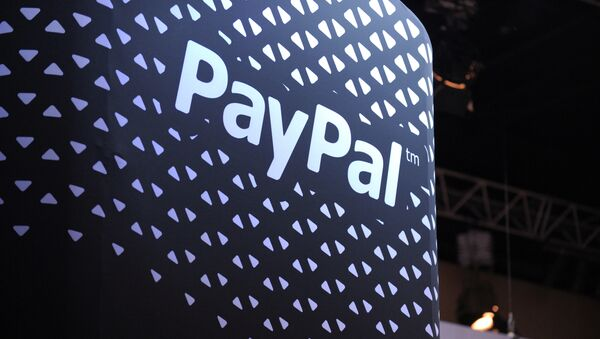 The logo of online payment company PayPal is pictured during LeWeb 2013 event in Saint-Denis near Paris on December 10, 2013 - Sputnik International