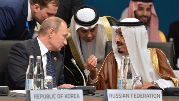 Russian President Vladimir Putin and Crown Prince, Deputy Chairman of the Council of Ministers, Defense Minister of Saudi Arabia Salman bin Abdulaziz Al Saud - Sputnik International