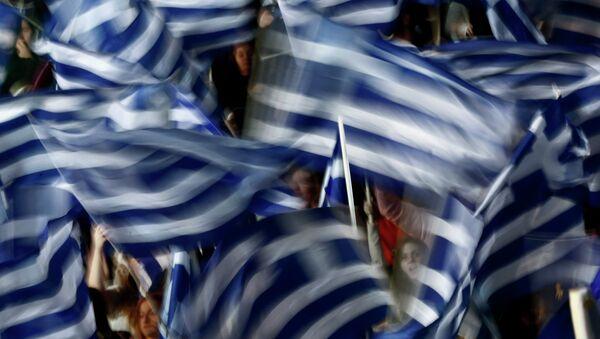 Supporters of Greece's Prime Minister Antonis Samaras wave Greek flags - Sputnik International