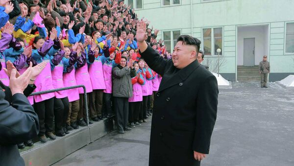 North Korean leader Kim Jong Un waves to a crowd as he provides field guidance to the Ryuwon Shoes Factory in this undated photo released by North Korea's Korean Central News Agency (KCNA) in Pyongyang January 21, 2015 - Sputnik International