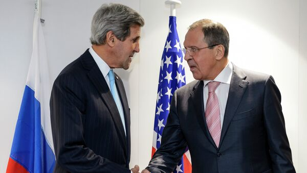 US Secretary of State John Kerry (L) and Russian Foreign Minister Sergei Lavrov shake hands during a bilateral on the side line of an Organization for Security and Cooperation in Europe (OSCE) ministerial meeting on December 4, 2014 - Sputnik International