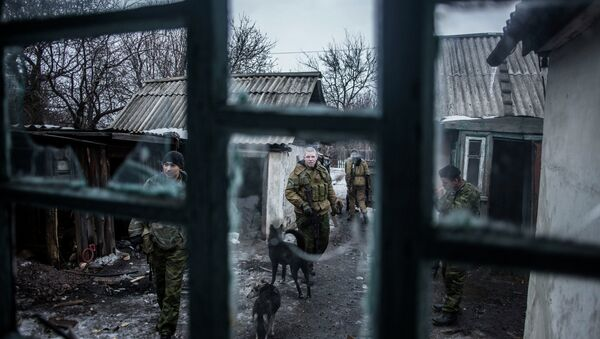 Independent suppoters patrol at an advanced post near the eastern Ukrainian city of Debaltseve, in the Donetsk region - Sputnik International