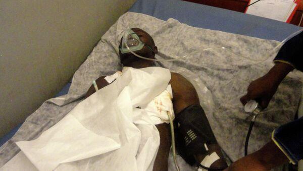 An injured man receives treatment in the main hospital in Gao - Sputnik International