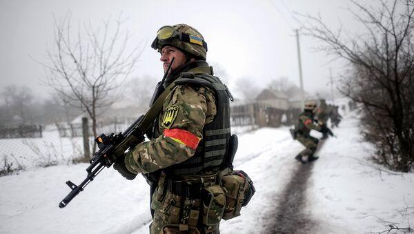 Ukrainian servicemen patrol Orekhovo village in Luhansk region January 28, 2015 - Sputnik International