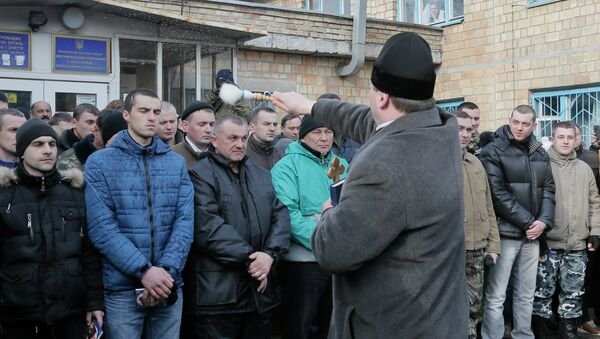 A priest blesses newly mobilized recruits in front of a military registration office before they leave for military units, in Kiev, Ukraine, Thursday, Jan.29, 2015 - Sputnik International