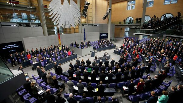 German Chancellor Angela Merkel, members of government and parliament observe a minute of silence to commemorate the victims of the attack at the Paris offices of French weekly satirical newspaper Charlie Hebdo - Sputnik International