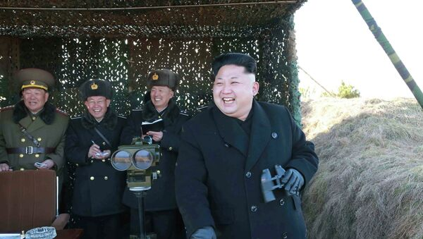 North Korean leader Kim Jong Un (R) laughs as he watches a drill by the Korean People's Army (KPA) for hitting enemy naval target at undisclosed location in this undated photo released by North Korea's Korean Central News Agency (KCNA) in Pyongyang January 31, 2015 - Sputnik International