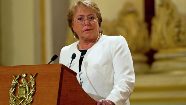 Chile's President Michelle Bachelet listens to Guatemala's President Otto Perez Molina during their joint press conference at the National Palace in Guatemala City, Friday, Jan. 30, 2015 - Sputnik International