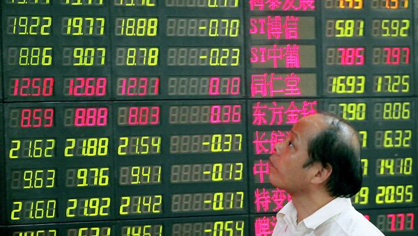 An investor looks at a stock price monitor at a private securities company - Sputnik International
