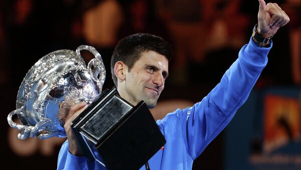 Novak Djokovic of Serbia holds the trophy after defeating Andy Murray of Britain in the men's singles final at the Australian Open tennis championship in Melbourne, Australia, 1 February 2015 - Sputnik International