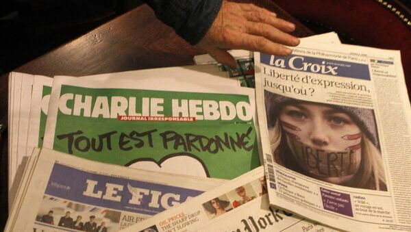 Copies of the latest issue of Charlie Hebdo newspaper are sold with other newspapers at a newsstand in Lille, northern France - Sputnik International