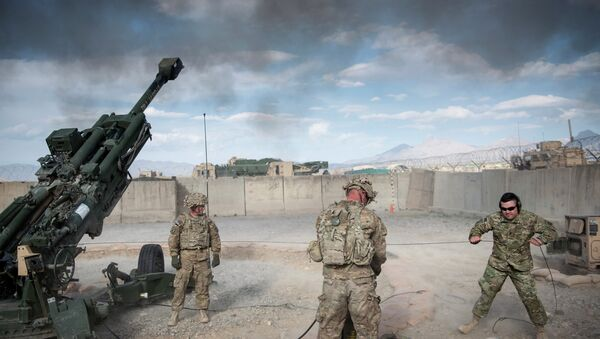 This photo taken on May 28, 2014 shows US Army Sergeant (retired) Joshua Ben, of Missouri (R) who lost his leg to an Rocket Propelled Grenade (RPG) in Afghanistan's Jalrez Valley in 2007, firing artillery during 'Operation Proper Exit' at Forward Operating Base Shank in Afghanistan's Logar Province - Sputnik International