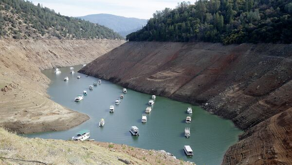 houseboats sit in the drought-lowered waters of Oroville Lake, near Oroville, California. - Sputnik International