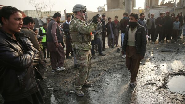A US soldier at the site of a suicide car bomb attack in Kabul, Afghanistan. - Sputnik International