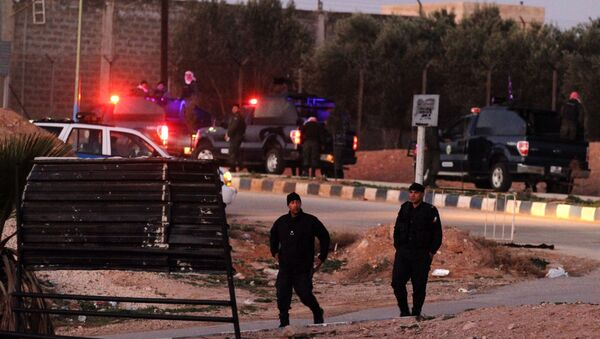 Jordanian security stand guard outside Swaqa prison, after the executions of Sajida al-Rishawi and Ziad al-Karbouly, two Iraqis linked to al-Qaida, about 50 miles (80 kilometers) south of the Jordan's capital, Amman, Wednesday, Feb. 4, 2015. - Sputnik International