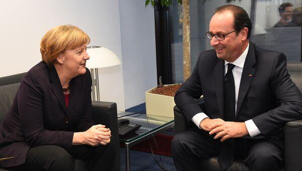 German Chancellor Angela Merkel and French President Francois Hollande - Sputnik International