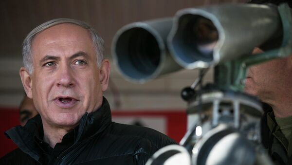 Israel's Prime Minister Benjamin Netanyahu visits at a military outpost during a visit at Mount Hermon in the Israeli-controlled Golan Heights overlooking the Israel-Syria border. - Sputnik International