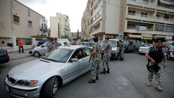 Lebanese security forces man a checkpoint in the southern suburb of the capital Beirut - Sputnik International