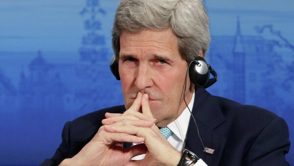 U.S. Secretary of State John Kerry listens to a speech of German Foreign Minister Frank-Walter Steinmeier on the podium during the 51. Security Conference in Munich, Germany, Sunday, Feb. 8, 2015 - Sputnik International