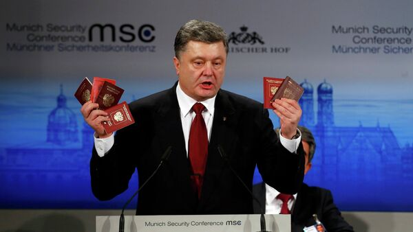 Ukrainian President Petro Poroshenko holds Russian passports meant to prove the presence of Russian troops in Ukraine as he addresses the 51st Munich Security Conference, February 7, 2015 - Sputnik International