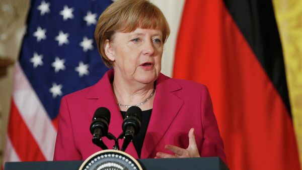 German Chancellor Angela Merkel speaks as she holds a joint news conference with U.S. President Barack Obama in the East Room of the White House in Washington February 9, 2015 - Sputnik International