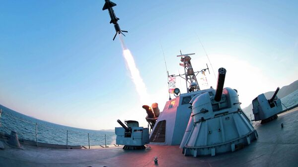 A missile is fired from a naval vessel during the test-firing of a new type of anti-ship cruise missile to be equipped at Korean People's Army (KPA) naval units. - Sputnik International