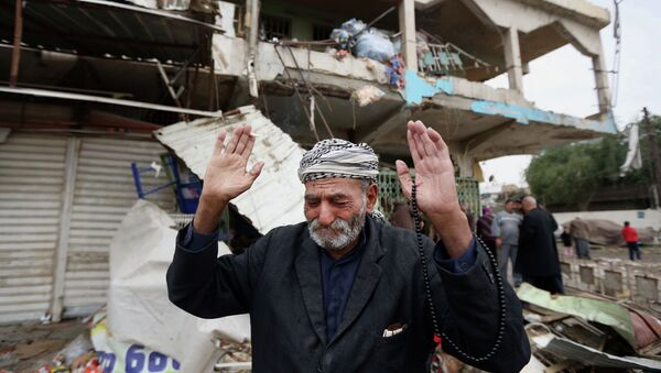In this Tuesday, Nov. 25, 2014 file photo, an Iraqi man reacts at the site of a car bomb explosion, in the Shaab neighborhood of Baghdad, Iraq in a crowded marketplace that killed and wounded civilians - Sputnik International