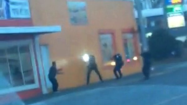 In this still frame taken from a cell phone video provided by Dario Infante and taken on Feb. 10, 2015, Antonio Zambrano-Montes, left, turns to face police officers as one holds a flashlight and two others draw their guns just before shooting him in Pasco, Wash. - Sputnik International