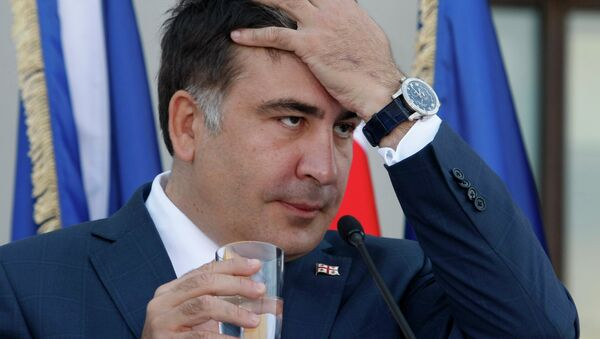 Georgian President Mikhail Saakashvili gestures during a news conference with NATO Secretary General Anders Fogh Rasmussen in the presidential palace in Tbilisi on June 27, 2013 - Sputnik International