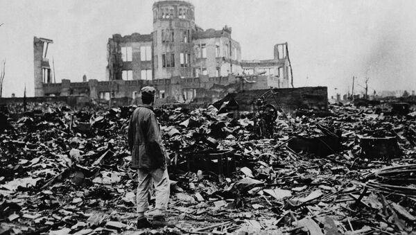 Aman looks over the expanse of ruins left the explosion of the atomic bomb on August 6, 1945 in Hiroshima, Japan - Sputnik International