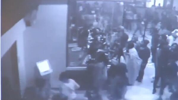 Screenshot of security camera footage from a Florida theater in which 900 teens rampaged through for free movies - Sputnik International