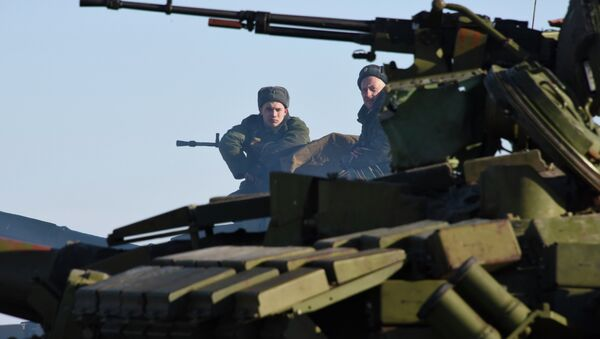 In this Wednesday, Jan. 14, 2015 photo members of the armed forces of the self-proclaimed Luhansk People's Republic sit on top a tank at the check-point north of Luhansk, Eastern Ukraine - Sputnik International