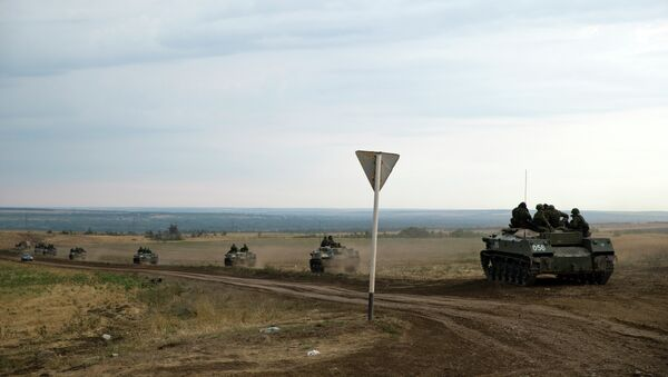 A number of Russian APC's move in a field in about 10 kilometers from the Russia-Ukrainian border control point near the town of Donetsk, Rostov-on-Don region, Russia, Monday, Aug. 18, 2014. File Photo. - Sputnik International
