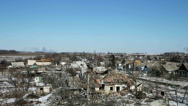 Buildings damaged by fighting are pictured in the village of Nikishine, south east of Debaltseve February 17, 2015 - Sputnik International